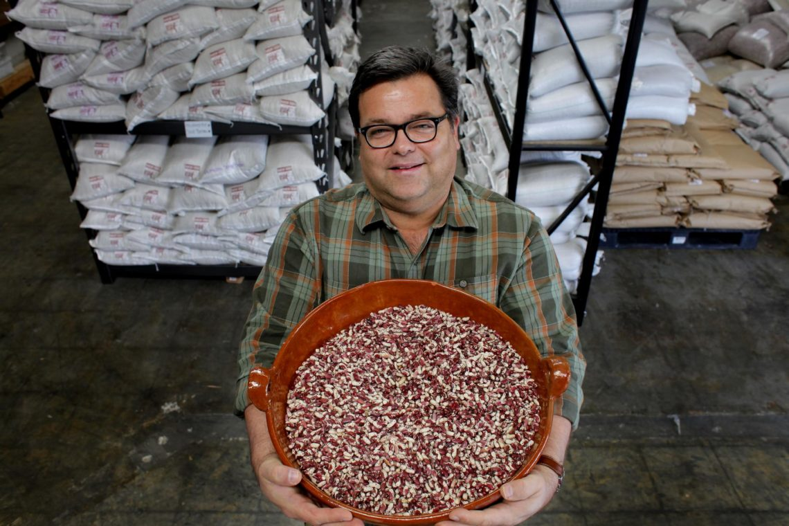 "Steve Sando , founder of Rancho Gordo, an heirloom bean company, shows off the ""Good Mother Stallard"" bean, Wednesday April 13, 2011, in Napa, Calif.  Ran on: 04-16-2011 Steve Sando displays a tub of Good Mother Stallard beans at his Rancho Gordo company in Napa. Sando started the business in his living room 10 years ago with a dream of marketing beans indigenous to North and Central America."